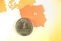 Polish coin. Closeup photo of one polish zloty over map Royalty Free Stock Image