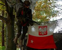 Polish commando and flag. Polish gunner`s dummy with arms and Polish flag, tourist trail decoration on the Hel Peninsula stock image
