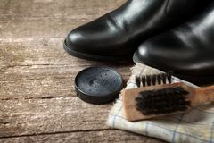 Polish cream,black boots,brush and cloth Stock Images