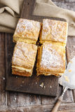 A Polish cream pie made of two layers of puff pastry, filled wit Royalty Free Stock Images
