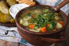Polish cucumber soup in a brown bowl close-up Stock Image