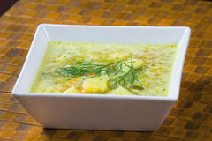 Polish cucumber soup. On wooden background royalty free stock photos