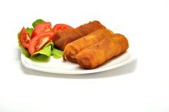 Polish Cuisine. Croquette and tomato. Polish Cuisine. Croquette and tomato on white plate Stock Photos