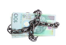 Polish currency with chain for security and investment Stock Photography