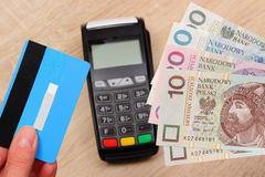 Polish currency money and credit card with payment terminal in background, finance concept Stock Images