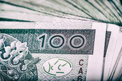 Polish currency PLN, money. File roll of banknotes of 100 PLN P Royalty Free Stock Photography