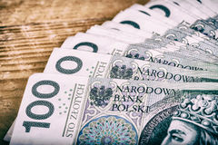 Polish currency PLN, money. File roll of banknotes of 100 PLN & x28;P Stock Images