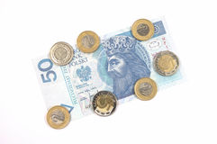 Polish currency 50 zloty and coins Royalty Free Stock Photos