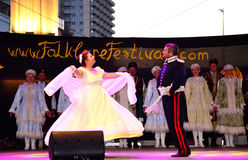 Polish dancers stage performance. Polish couple performing romantic dance at stage of the International Folk Festival  on Varna city square on July 5th 2016 Stock Image