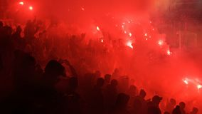 A Polish Derby. KRAKOW, POLAND-DECEMBER 13, 2017: Polish soccer fans lighting smoke flares at Cracovia Stadium, during the Polish Premiere League match Cracovia Royalty Free Stock Photos
