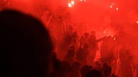 A Polish Derby. KRAKOW, POLAND-DECEMBER 13, 2017: Polish soccer fans lighting smoke flares at Cracovia Stadium, during the Polish Premiere League match Cracovia Stock Image