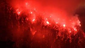 A Polish Derby. KRAKOW, POLAND-DECEMBER 13, 2017: Polish soccer fans lighting smoke flares at Cracovia Stadium, during the Polish Premiere League match Cracovia Stock Photo