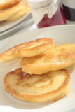 Polish doughnuts. Close-up view of three Polish doughnuts (racuchy) on plate with blurred background. Oblique view stock images