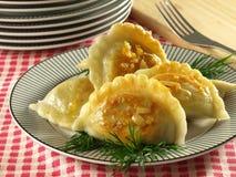Polish dumplings for Christmas with sauerkraut. Traditional Polish dumplings with filling royalty free stock photography