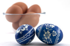Polish easter eggs with fresh ones in glass cup Stock Photo