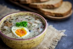 Polish easter soup with eggs and white sausage royalty free stock images