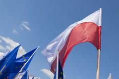 Polish and EU Flags against the Sky Royalty Free Stock Photos