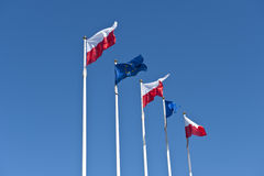 Polish and EU flags on sky background Royalty Free Stock Photography