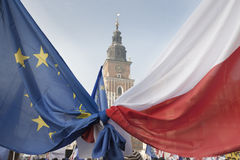 Polish and EU Flags Tied Together, Krakow Town Hall Tower Stock Photos