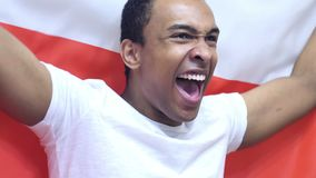 Polish Fan Celebrating while holding the Flag of Poland in Slow Motion. 4k , high quality stock footage