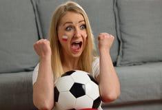 Polish fan cheers football team. Stock Photo
