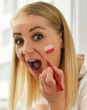 Polish fan cheers football team. Stock Photography