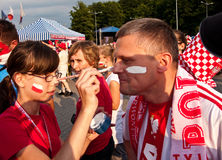 Polish fans before a sport event. Polish fans having their faces painted in national white and red colors, before entering Luczniczka  arena in Bydgoszcz Royalty Free Stock Photos