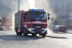 Polish Fire Service Emergency Vehicles. Polish Fire Service vehicles speeding to an emergency on the streets of Krakow in Poland Stock Photos