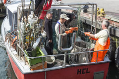Polish fishermen working with net Royalty Free Stock Photography
