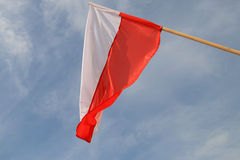 Polish flag. Waving in the wind on the cloudy sky Stock Photos