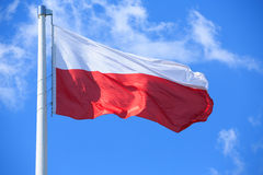 Polish flag. On a background of blue sky Royalty Free Stock Images