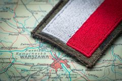 View of the Polish flag on the background of the Poland map. Polish flag on the background of the Poland map stock photo