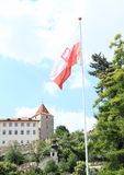 Polish flag. On Embassy of Poland in Prague (Czech Republic) with Prague Castle behind stock photos