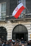 Polish flag flying at half-staff. Commemorating the death of President Kaczynski in the air crash. Polish Embassy in London. The official week of mourning royalty free stock photo