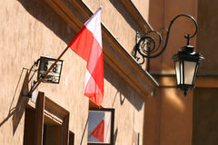 Polish flag and lantarn in background Stock Image