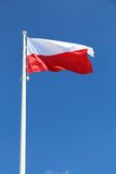 Polish flag. National colors of Poland on a flagpole royalty free stock photo