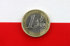 Polish flag with one Euro coin. Stock Photos