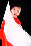 Polish flag & polish girl. A picture of a happy Polish female fan with the flag over black background stock image