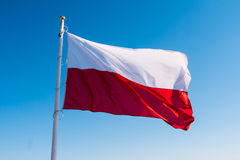 Polish flag in the sky. Polish flag waving in the sky Royalty Free Stock Photo