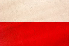 Polish flag with the texture of plaster wall Stock Images