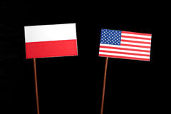 Polish flag with USA flag on black. Background stock images