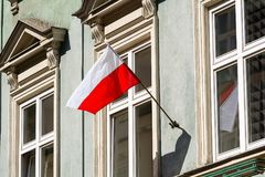 Polish flag on the wall. In Krakow Poland stock images