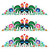 Polish floral embroidery pattern with roosters Stock Photos
