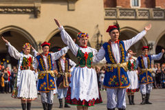Polish folk collective on Main square during annual Polish national and public holiday the Constitution Da Stock Images