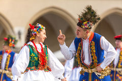 Polish folk collective on Main square during annual Polish national and public holiday the Constitution Da Stock Photos