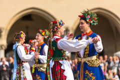Polish folk collective on Main square during annual Polish national and public holiday the Constitution Day Stock Photography