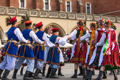 Polish folk collective on Main square during annual Polish national and public holiday the Constitution Day Royalty Free Stock Image