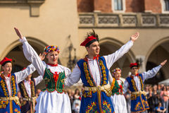 Polish folk collective on Main square during annual Polish national and public holiday the Constitution Day Stock Photo