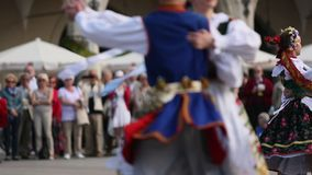 Polish folk collective on Main square during annual Polish national and public holiday the Constitution Day stock video footage