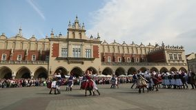 Polish folk collective on Main square during annual Polish national and public holiday the Constitution Day stock footage